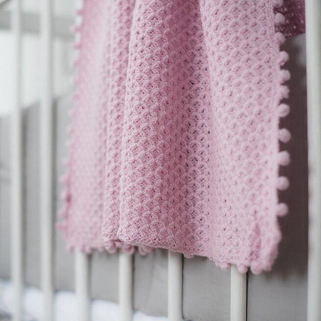 Šiltas rožinis vilnonis megztas pledukas
